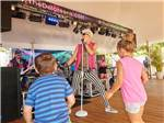 View larger image of Live band on stage at CHESAPEAKE BAY KOA  SUNSET BEACH HOTEL image #9