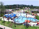 View larger image of Aerial view over campground at REUNION LAKE RV RESORT image #2