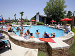 View larger image of People swimming in pool at REUNION LAKE RV RESORT image #11