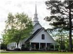 View larger image of Church with steeple at QUAIL CREEK RV RESORT image #9