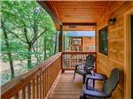 View larger image of A couple of chairs on the front porch of the camping cabins at PIGEON RIVER CAMPGROUND image #6