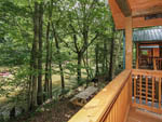 View larger image of Cabin with deck overlooking flowing river at PIGEON RIVER CAMPGROUND image #8