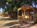 View larger image of Three cabins with decks at ABOVE AND BEYOND RIVER RESORT RV PARK image #7
