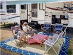 View larger image of Couple and their dogs relaxing by their RV at LA CONNER MARINA RV RESORT AT PORT OF SKAGIT image #5