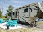 View larger image of Family sitting next to a blue motorhome at THE RESORT AT MASSEYS LANDING image #2