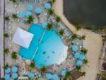 View larger image of Couple sitting on bar stools inside the pool at THE RESORT AT MASSEYS LANDING image #7