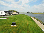 View larger image of Trailers and RVs camping on the water at EASTPOINTE RV RESORT image #7