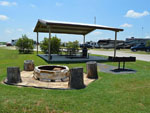 View larger image of Patio area with picnic table at BRAZOS VALLEY RV PARK image #2