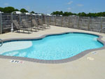 View larger image of Swimming pool with outdoor seating at BRAZOS VALLEY RV PARK image #4