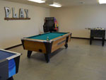 View larger image of Pool table in game room at the lodge at BRAZOS VALLEY RV PARK image #5
