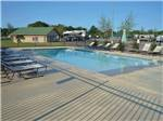 View larger image of Playground with swing set at TYLER OAKS RV RESORT image #3