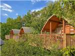 View larger image of Row of cabins with balconies at RIVEREDGE RV PARK  CABIN RENTALS image #3