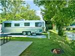View larger image of Trailers camping on gravel sites at RIVEREDGE RV PARK  LOG CABIN RENTALS image #6