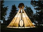 View larger image of Glowing teepee at night at BUFFALO RIDGE CAMP RESORT image #6
