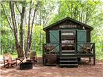 View larger image of Cabin with a porch and fire pit at SANDY PINES CAMPGROUND image #4