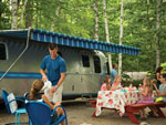 View larger image of Family camping in trailer at SANDY PINES CAMPGROUND image #8