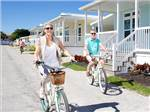 View larger image of Couple riding bikes at OCEAN BREEZE RESORT image #7