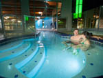 View larger image of Couple in pool at 12 TRIBES RESORT CASINO RV PARK image #11