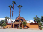 View larger image of Lodge Office with palm trees at CATHEDRAL PALMS RV RESORT image #1