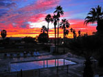 View larger image of Sunset at the pool at CATHEDRAL PALMS RV RESORT image #5