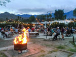 View larger image of Camp fires with campers on patio at CATHEDRAL PALMS RV RESORT image #6
