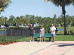 View larger image of Three people playing Bocce ball at PALM BEACH MOTORCOACH RESORT image #10