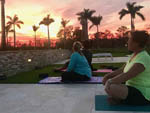 View larger image of A couple of women performing Yoga at dawn at PALM BEACH MOTORCOACH RESORT image #11