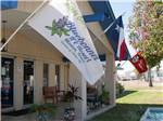 View larger image of Flags on the front of the main building at BLUEBONNET RV RESORT image #1