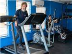 View larger image of A man and lady using the exercise equipment at BLUEBONNET RV RESORT image #7