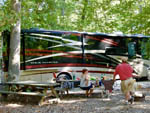 View larger image of Couple camping at HOLLY LAKE CAMPSITES image #4