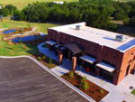 View larger image of Aerial view of office building at WANDERLUST CROSSINGS RV PARK image #7