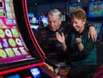 View larger image of Couple at casino at NORTHERN QUEST RV RESORT image #11