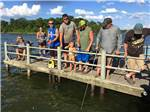 View larger image of Campers fishing on pier at SHILOH ON THE LAKE image #4