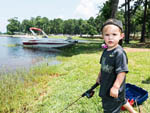 View larger image of Boy fishing at TOLEDO BEND RV RESORT AND CABINS image #1