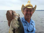 View larger image of Man showing off fish at TOLEDO BEND RV RESORT AND CABINS image #2