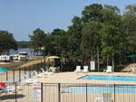 View larger image of Swimming pool with outdoor seating at TOLEDO BEND RV RESORT AND CABINS image #11