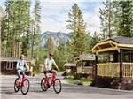View larger image of A couple riding their bikes at WEST GLACIER RV PARK  CABINS image #6