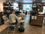View larger image of Older man sitting at deli table at BEAR CREEK ARTICHOKES image #5