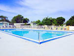 View larger image of Swimming pool with outdoor seating at LAKEWOOD VILLAGE RV RESORT image #4