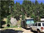 View larger image of RVs camping with wooden building in background at RUSHMORE VIEW RV image #1