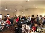 View larger image of Man sailing on sailboat at AHOY RV RESORT image #11