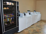 View larger image of Laundry room with washer and dryers and vending machine at LEISURE LANE RV RESORT image #4