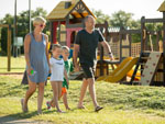 View larger image of Family at playground at SPLASHWAY WATERPARK  CAMPGROUND image #4