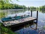 View larger image of Boats docked on lake at TUXBURY POND RV RESORT image #9