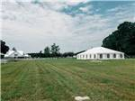 View larger image of Outdoor seating by the pool at CREEKFIRE RV RESORT image #5