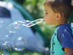 View larger image of Kid blowing bubbles at DEVILS BACKBONE CAMP image #3
