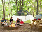 View larger image of Family camping in tent at DEVILS BACKBONE CAMP image #5