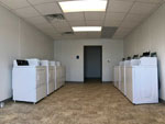 View larger image of Laundry room with washer and dryers at EVANGELINE OAKS RV PARK - IOWA image #5
