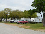View larger image of Trailers camping at campsite at LA MANCHA LAKE RESORT image #1