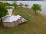 View larger image of Aerial view of water over campground at LA MANCHA LAKE RESORT image #3